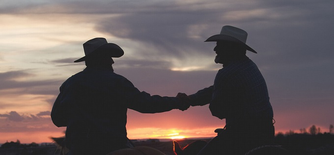 Cowboys shaking hands