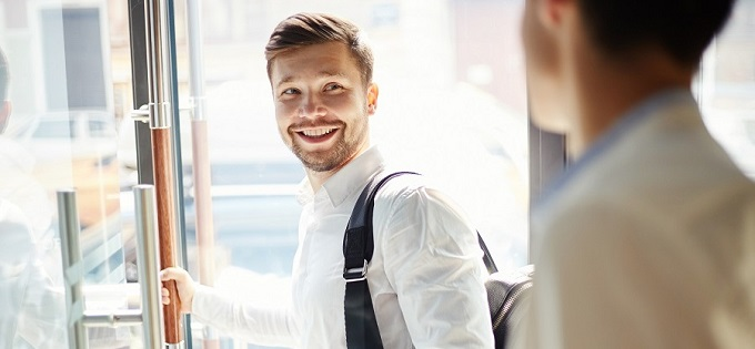 Smiling employee exiting