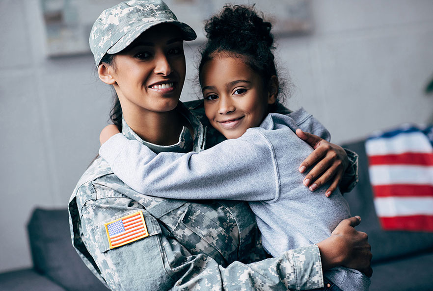 Female veteran holding her daughter